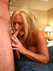 Hot mature MILF choking on a rock hard dick