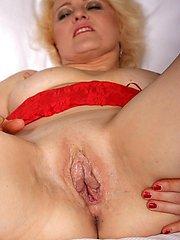 Horny blonde mature slut grinding on her bed