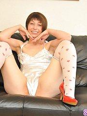 Cute Paula teases in nightie and stockings