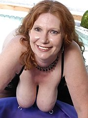 Stacked granny shows off her huge titties!