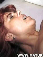 Mature red-haired in hot action