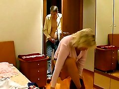 He watches the sexy mature blonde put her clothes on and then he comes in and makes his move.