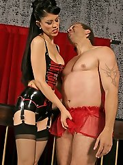 Stunning domina practicing a whipping session on her roped and gagged slave