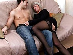 Sinful mature blonde in sexy black stockings shamelessly fucking some hot college boy