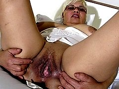 Blonde mature slut playing with her big dildo