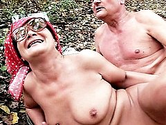 Granny Szandra and her man undresses in the woods getting into sixty nine sucking