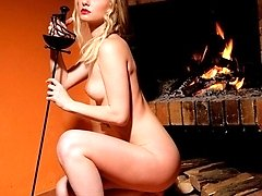 Hot blonde seductress gets naked and poses sexy with a sword