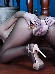 Sexy babe goes for solo assfucking play showcasing feet in pantyhose and high heels