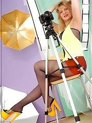 Angel in sheer dark-hued xxl over shiny tan pantyhose