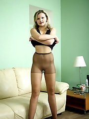 Upskirt girl slowly strips to her sheer pantyhose revealing all her goodies
