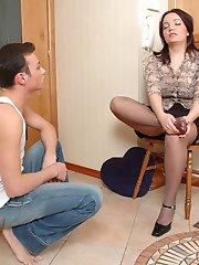 Sweltering brunette squeezing mighty cock with her feet clad in silky hose