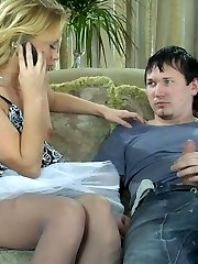 Marvelous blondie in a flying skirt and soft grey hose getting nailed on a sofa