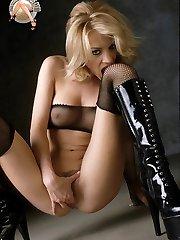 Blonde pornstar Nicolete in latex stilettos and fishnet stocking fetish toying vag