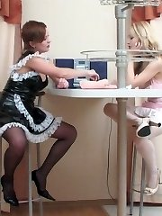 Two uniformed French maids spreading stockinged legs finger-tickling itchy pussy