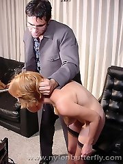 Naughty assistant in stockings gets spanked by her boss and shows her pink snatch