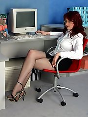 Redhead secretary munching her extremely tempting tights during lunch hour