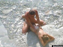 Real nude people enjoying the sea and having beach fun