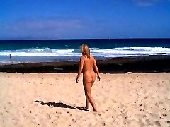 Big boob and slim teen nudists lay out in the sun