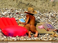 Naked girl enjoying the sun at nude beach