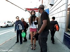 Lexington Steele Joins Public Disgrace in his FIRST EVER KINK.COM SHOOT. Watch as he parades his gagged and bound whore down the streets of San Francisco, ordering her to serve as an ash tray for passers by. Then he drags her into the Loin as a surprise for his friend Gage. Together they defile and humiliate her in front of the patrons. Princess Donna even joins in, when she see's this obedient slut in the window, she can't resist getting her hands dirty in this interracial fuck fest. Bondage, Breath Play, Sensory Deprivation, Humiliation, Rough Sex, Anal, and Squirting!