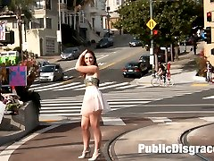 Sweet slutty Jodi wanders the streets of San Francisco with her ass out for all to see. She finds a group of nudists and then stumbles upon a flower shop.  Her fantasy comes to life when she is dominated into submission in front of customers. She's rope bound, fucked by a huge cock, and dominated by beautiful female patrons. She's is covered in cum and piss.