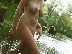 Girlfriend with huge tits naked by the pond