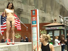 Juliette March is an embarrassment to the USA. This slutty loser tourist with her pathetic selfie stick is lost in Madrid! Mona Wales doesn't even want to be seen with her. Luckily no one is better at humiliating Juliette March more than herself. She gets fully nude in a crowded downtown area and drapes an American flag around herself. After shaming herself in front of everyone, she is hungry for Euro COCK! At a crowded bar this anal slut gets double filled and fucked hard in rope bondage. Everyone there gets a piece of this american pie!Check out the behind the scenes footage for this shoot at  Behind Kink!