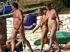 Nudist paramours caught by spy camera having sex fun in water