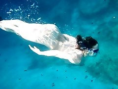 Girlfriend diving in the nude outdoors