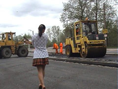 Naughty exhibitionist surrounded by road workers