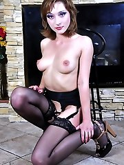 Pretty gal in black gartered nylons gets to upskirt tease and pussy spreads