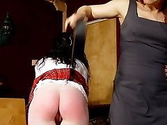 Two pretty young schoolgirls spanked and paddled on their bared asses