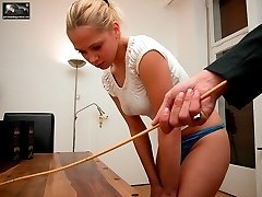 Caned over tight jeans then caned on her bare ass until striped