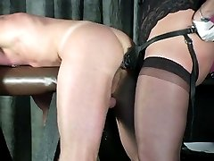Slave to her black strapon