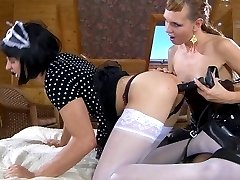Dressed like a maid sissy licks a strapon and gets fucked by his mistress