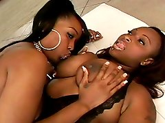 Sexy ebony babes play lesbian games and fuck each other with strapon dildos on the floor