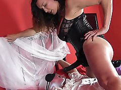 Strapon Jane gives her blushing bride a mouthful of her big black strapon, before torturing her...