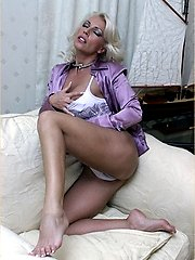 Leggy Milf Lana Cox peels off her nylon panties for a naughty play on the sofa
