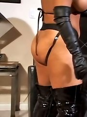 Sexy busty slut double fucked by two latex strapon lesbians