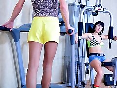 Sporty sissy in a skimpy outfit and a blond wig gets his bum strapon fucked