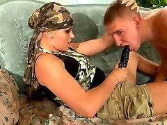 Funky army girl four-fingers a male ass and puts to use her rubber weapon