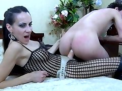 Hot dominatrix puts to use a strapon toy to discipline and fuck a male sub