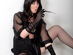 Femdom Helga looks so seductive as she smokes