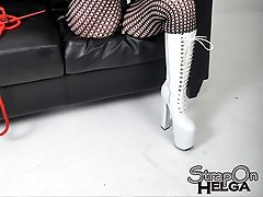 Helga shows off her gorgeous legs through fishnet stockings