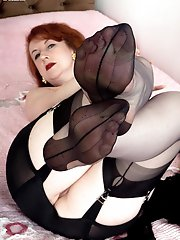 Mature Red teasing in black ff nylons and leopard print