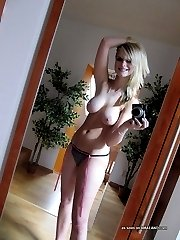 Heavy-chested blonde shows tits and pussy