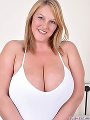 Carol Brown plays with her huge melons and toy rams her cunt