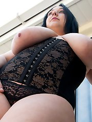 Nikkie getting naked and showing off her curves on a balcony
