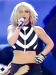 Britney plays dirty stripping on stage