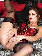 Slim busty brunette in satin corset and RHT nylons